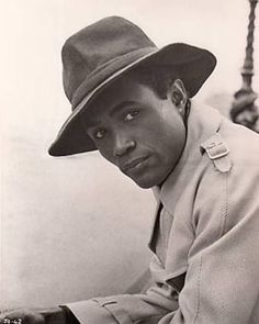 """Calvin Lockhart [1934-2007] was a Bahamian-American actor on stage and in film. He was best known for the role of a big-time gangster """"Biggie Smalls"""" in the 1975 film Let's Do It Again, not to be confused with the deceased rapper Biggie Smalls."""