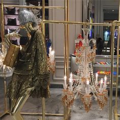 """BERGDORF GOODMAN, New York, """"She's singing to-night to bring the chandelier down"""", pinned by Ton van der Veer"""