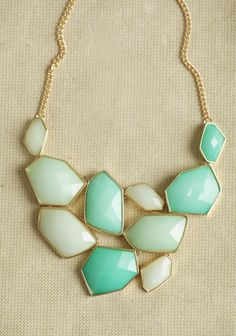 Lovin this color!    Mint Escapade Jeweled Necklace 19.99 at shopruche.com. Perfected in hues of mint and pistachio, this gorgeous gold-toned necklace features a medley of abstract pendants for a unique statement look.9