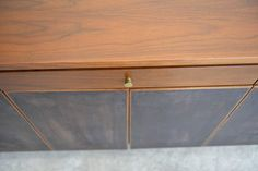Paul McCobb for Calvin Walnut and Leather Front Credenza | From a unique collection of antique and modern credenzas at https://www.1stdibs.com/furniture/storage-case-pieces/credenzas/