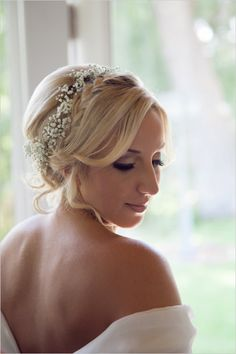 Romantic wedding hair with baby's breath and braids