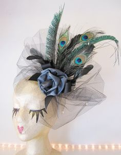 I love everything about this hat, especially the peacock feathers! Wish I was in England and had a wedding to attend.