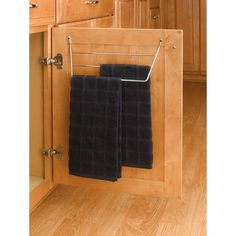 Store your dish towels where you need them - right under the kitchen sink. This towel holder is made of wire and easily fastens to any cabinet door.