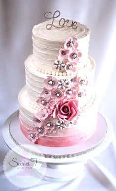 Engagement or wedding cake by Tina of Sweet T & Cakes - vintage look with pink flowers, pearls and bling