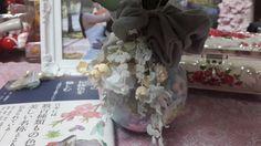 I put my hair band around the vase.