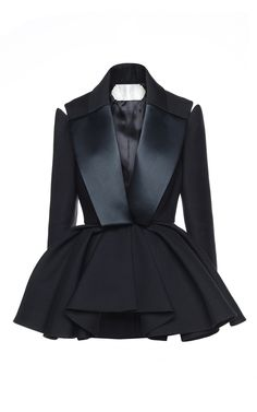 This black **Dice Kayek** smoking jacket is rendered in wool and features a dramatic peplum, satin lapels and splits at the shoulders.