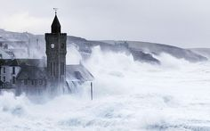 Huge waves engulf the Bickford-Smith Institute in Porthleven, Cornwall, 10 Feb 2014