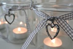 Glass Jar T-Lights - Divine Shabby Chic Adorable Glass Jar T-ights   Perfect for adding soft mood lighting to the home or garden   A collection can make a wonderful display   Each jar measures 10cm x 10cm   With gingham ribbon and metal heat detail