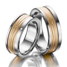 Eheringe ars amandi, Ring Edelstahl, Inlay Roségold 585/- Breite: 7,50 - Höhe: 2,50 - Steinbesatz: 1 Brillant 0,01 ct. tw, si (Ring 1 mit Steinbesatz, Ring 2 ohne Steinbesatz). Alle Eheringe können Sie individuell nach Ihren Wünschen konfigurieren.