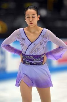 Figure skater Mao Asada lets out a breath before her first performance after a yearlong hiatus at the 2015 Japan Open figure skating competition at Saitama Super Arena, on Oct. 3, 2015. (407×620) http://mainichi.jp/graph/2015/10/03/Asada/001.html