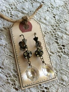 etsy   Good idea.  Use bigger tags.  Have long hooks to hang several from each