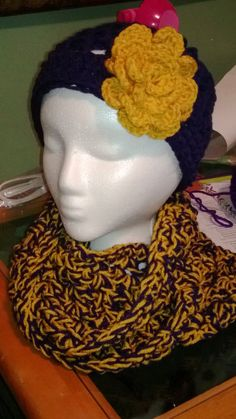 Mountaineer Hat and Cowl Set    Cowl pattern by One Dog Woof (http://www.1dogwoof.com/2013/03/cal-party-time.html)  Hat pattern by JJCrochet (http://www.jjcrochet.com/blog/free-crochet-hat-pattern-free-pattern-friday/)  Flower pattern by Crochetgeek (www.crochetgeek.com/2009/07/slinky-crochet-flower.html)