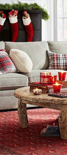 Classic christmas style with modern cozy & modern touches. LOVE the plaid! And the classic red stockings. And those mercury glass candles! #christmas #xmas