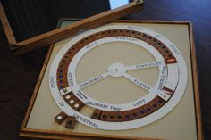 The Liturgical Calendar Puzzle- wood and plexiglass, by Roy Emmes