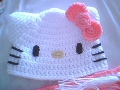 Gorro Hello Kitty a crochet and like OMG! get some yourself some pawtastic adorable cat apparel! Crochet Cap, Crochet Beanie, Crochet Crafts, Yarn Crafts, Amigurumi Patterns, Crochet Patterns, Hello Kitty Crochet, Crochet Baby Clothes, Kids Boutique