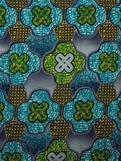 Real Wax African wax block print fabric  via Etsy