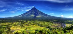 Mayon Volcano in Albay Province, Philippines Photo by Sinjin Pineda Volcano World, Places Around The World, Around The Worlds, Paises Da Africa, Monte Everest, Active Volcano, Fjord, Natural Park, Philippines Travel
