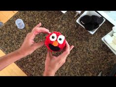 If you don't want to go the store bought route for the cake (or cupcakes) you can follow this great video tutorial on how to make yourself an Elmo, Oscar and Cookie monster with just a few decorating ingredients.