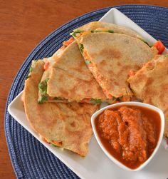 Loaded Vegetarian Quesadillas     2 large Lebanese pocket;1/2 c mashed sw potato; 3/4 c roasted pepper strips; 1 stalk green onion chopped; 1 handful fresh spinach, chopped;1/2 C refried beans; 3/4 C grated pepperjack cheese!  Assemble, bake 350 10 min!