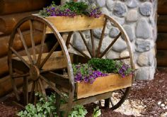 Another adorable garden idea made of old wagon wheels and boxes.