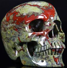 Dragon Blood Jasper Carved Crystal Skull