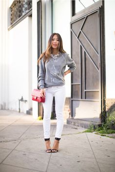 Aimee Song embodies casual elegance with a boyfriend sweater and J BRAND Triple Zip Denim.
