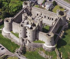 Harlech Castle, located in Harlech, Gwynedd, Wales, is a medieval fortification, built by Edward I. It's one of seven built across North Wales in the wake of the 1282 campaign. Construction took place under the overall direction of the famous architect and engineer James of Saint George.