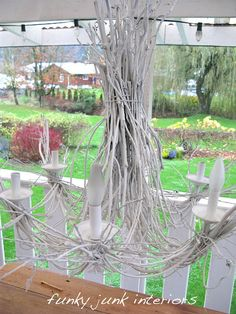 DIY twig chandelier. I love the rustic look!