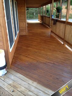 Pressure treated lumber front porch stained with DEFY Extreme Stain in cedar tone (Outdoor Wood Stain) Deck Stain Colors, Deck Colors, Exterior Wood Stain Colors, Cedar Deck Stain, Outdoor Wood Stain, Cedar Fence, Porch Wood, Porch Flooring, House With Porch
