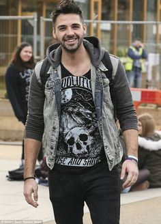Hunky: X Factor heartthrob Ben Haenow rocked a low cut T-shirt and flashed a bit of chest hair while out and about in London on Wednesday