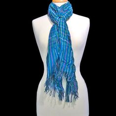 You'll have fun finding new ways to tie this scarf - it's long enough to use in a multitude of ways!  A gorgeous shade of turquoise is the primary color - accented with a checkered pattern in multicolors.