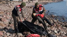 """A police officer holds the lifeless body of a boy near Ayvacik, Turkey, on Saturday, January 30. At least 33 people, including five children, were reportedly killed when a boat carrying migrants to Greece <a href=""""http://www.cnn.com/2016/01/30/world/europe-migrant-deaths/"""" target=""""_blank"""">capsized off the Turkish coast.</a> Greece is a major destination for those trying to escape war and poverty and get into Europe."""