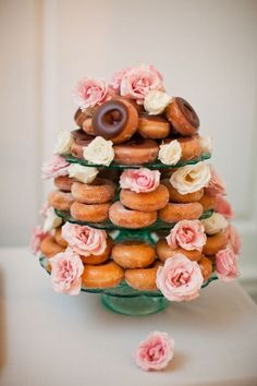 Looking to cut costs? A tower of doughnuts is an economical alternative to a traditional wedding cake. | Photo by Meg Ruth Photo via Elizabeth Anne Designs