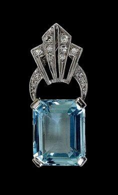 An Art Deco Aquamarine and Diamond Pendant corner. #VintageJewelry