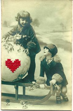 Cross stitched heart on old postcard from 1930, from Stich the World, via Etsy.