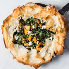 Skillet Phyllo Dough Pie with Butternut Squash, Kale & Goat Cheese. When overlapping the phyllo over the filling in this recipe, work carefully but quickly so the phyllo doesn't dry out before baking. Goat Cheese Recipes, Kale Recipes, Vegetarian Recipes, Cooking Recipes, Skillet Recipes, Recipies, Cooking Tips, Vegetarian Dinners, Brunch Recipes