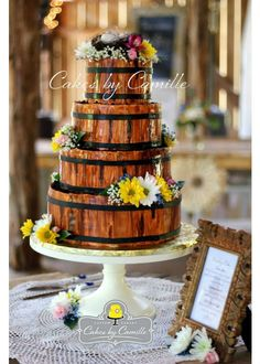 This cake from Cakes by Camille is a barrel of fun! The 14in ivory cake stand really helps add a touch softness to the realistic wood cake.