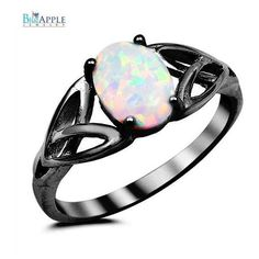 Black Gold White Lab Opal White Celtic Shank Lab Opal Oval Clear Split... ($29) ❤ liked on Polyvore