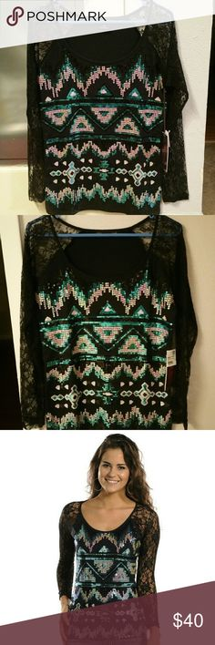 Rock and roll cowgirl aztec sequin lace sleeve top Rock and roll cowgirl long sleeve top! This top has an aztec sequin print on the front with full black lace sleeves. It's super cute and perfect for date night or a night out!! I'm selling because it's too big on me! Size womens medium and is true to size. New with tags and only tried on once. Open to reasonable offers Rock & Roll Cowgirl Tops