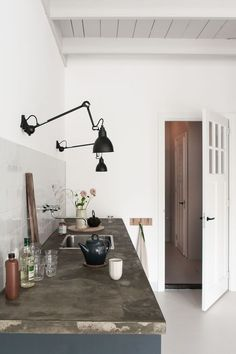 Black wall mounted task lighting in the kitchen black Lampe Gras wall lights kitchen lighting Kitchen of the Week: The Curtained Kitchen, Dutch Modern Edition - Remodelista Modern Kitchen Interiors, Interior Design Kitchen, Home Decor Kitchen, Industrial Chic Kitchen, Kitchen Wall Lights, Kitchen Lighting Design, Kitchen Lamps, Kitchen Chandelier, Kitchen Table Lighting