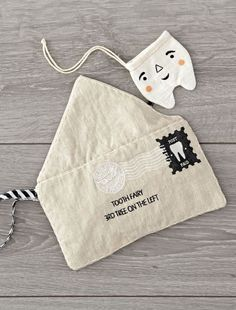 Sewing Projects For Children Shop Tooth Fairy Envelope. Tooth fairy envelope features a hook and loop closure and tooth-shaped bat, so the Tooth Fairy will have no problem locating any of those missing baby teeth. Sewing For Kids, Baby Sewing, Diy For Kids, Crafts For Kids, Fabric Crafts, Sewing Crafts, Sewing Projects, Diy Projects, Baby Crafts