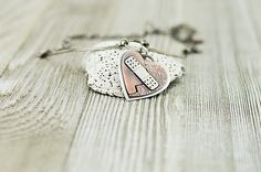 Mixed metal broken heart necklace mended heart by EchoesOfEla