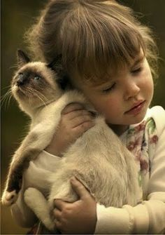 Child with her cat.