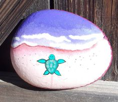 Sea Turtle-Rachel Inspired Painted Rock-Shimmering Purple Sea-Pink sparkling beach-Resin Sealed-Great gift for the turtle lover in your life – Painted rocks – Best Crafts Rock Painting Patterns, Rock Painting Ideas Easy, Rock Painting Designs, Paint Designs, Paint Ideas, Pebble Painting, Pebble Art, Stone Painting, Sea Turtle Painting