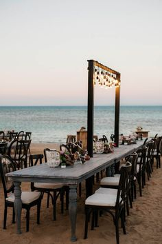 This beach wedding reception dinner is a dream | Image by Eric Ronald