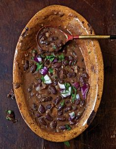 Coconut milk gives these long-simmered beans a smooth, supple texture that balances the bright flavors of the garlic, onion, and chiles.