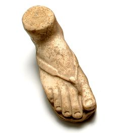 "Roman votive marble foot with Greek inscription which reads: ΦΛAIOC OMEIAOC KAIOAPEYC THKYPIA ANEΘHKE ""Plaios Omeia inhabitant of Caesarea dedicated to our Lady"". For similar limbs see: Votite objects from a Roman shrine at St. Anne's Church, Jerusalem; and from Caeasarea, BAR magazine 2004:5, p30."