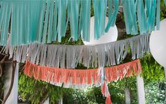 fringe banners (plastic tablecloths, made into garlands)