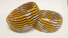 Check out this item in my Etsy shop https://www.etsy.com/listing/268419893/yellow-black-white-stripped-ankara