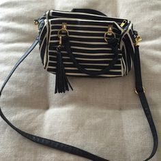 Striped purse Available for a LIMITED TIME-- Buy fast!  Priced low to sell fast! Reasonable offers are considered Low-ball offers are automatically declined All items ship out within a business day No modeling. No trades. Francesca's Collections Bags Crossbody Bags